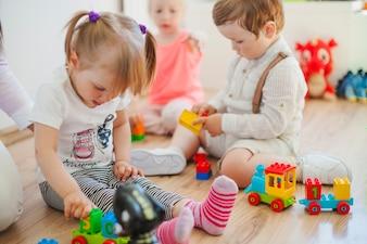 Kids in playroom on floor