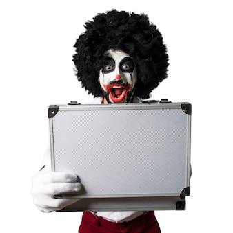 Killer clown holding a briefcase