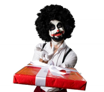 Killer clown holding a gift