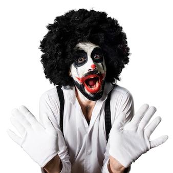 Killer clown making surprise gesture