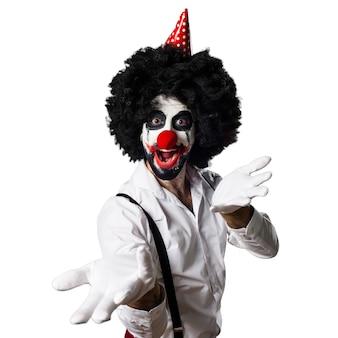Killer clown presenting something
