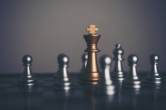 King and Knight of chess setup on dark background . Leader and teamwork concept for success.
