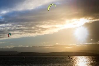 Kite surfing at evening