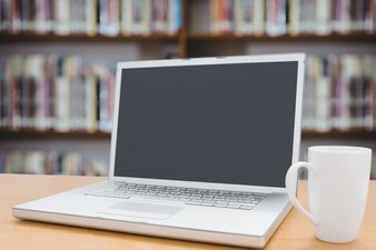 Laptop and cup with blurred background