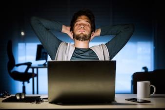 Laptop desk smile indoors male