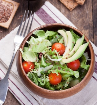 Large wooden bowl with salad