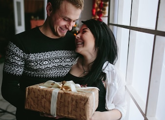 Laughing couple with wrapped present