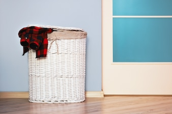 Laundry basket with red plaid shirt