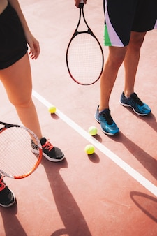 Legs of tennis couple