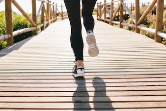 Legs of woman jogging