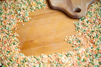 Lentils colors and a wooden cutting board