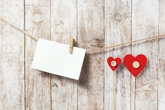 Letter hanging on a rope and two red hearts