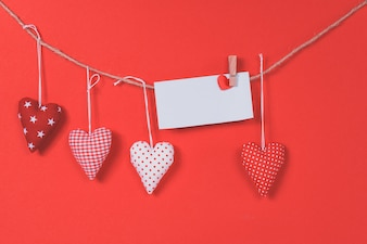 Letter hanging on a rope with hearts