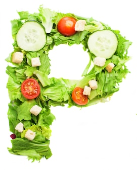 Letter p made of salad with croutons