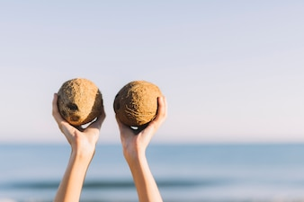 Lifting two coconuts in the air