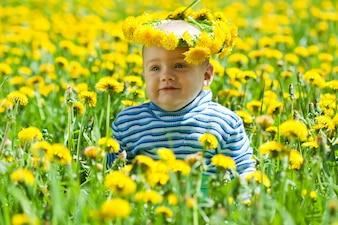 Little baby in flowers wreath