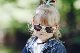 Little blond girl with sunglasses