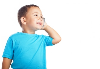Little boy smiling while talking on a phone