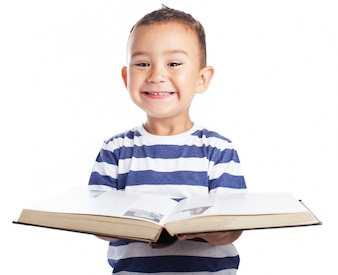 Little boy smiling with a book