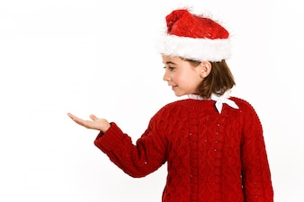 Little girl dressed in santa claus with a raised hand