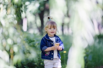 Little girl eating an ice cream and the rest of the image out of focus