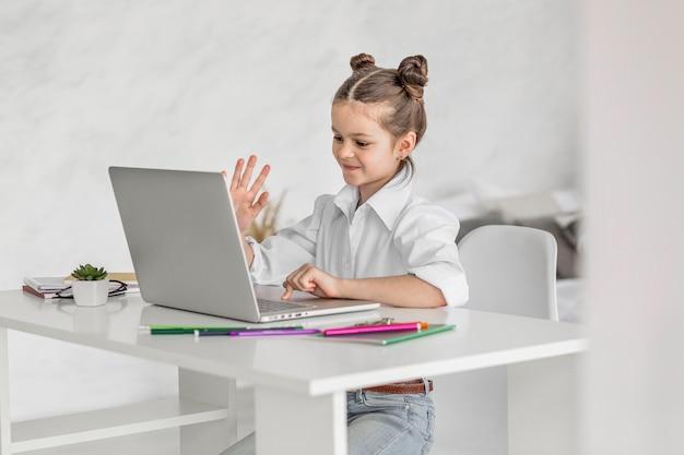 Little girl having an online class