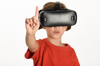 Little girl looking in VR glasses and gesturing with his hands.