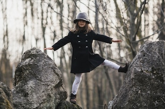 Little girl posing on rocks