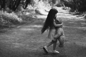 Little girl with a teddy bear