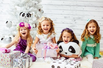 Little girls celebrating a party with teddies