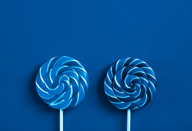 Lollipops on classic blue color