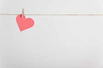 Lone paper heart hanging on rope