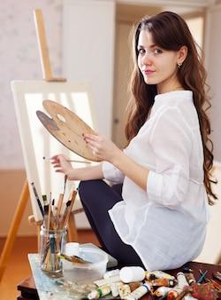 Long-haired female artist