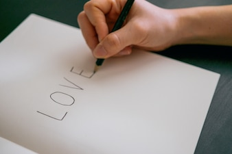 Love concept - Hand writing love on book