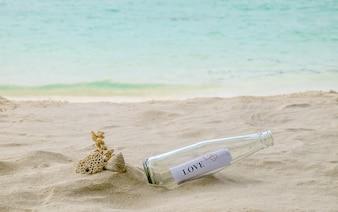 Love written on beach white sand.Vintage tone,retro filter effect,Soft focus,Low light.(selective focus)
