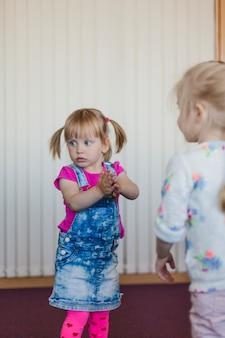 Lovely little girls standing in room