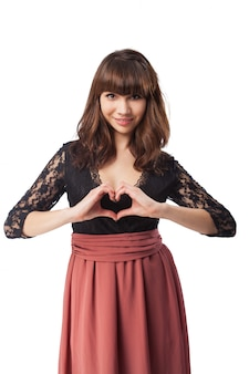 Loving girl making a heart with her hands