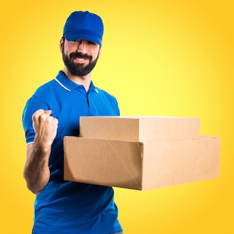 Lucky delivery man on colorful background