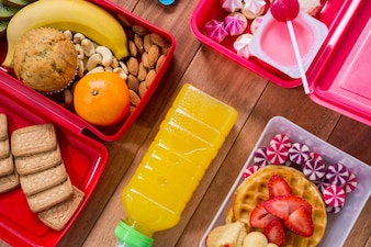 Lunch box with various snack and sweet food