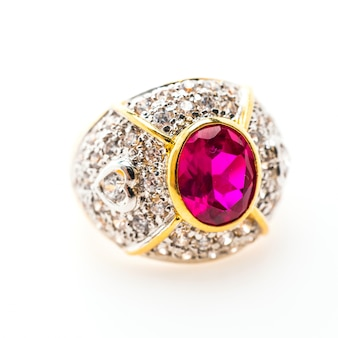 Luxurious golden ring with purple gemstone