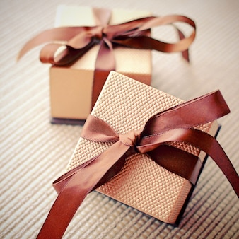 Luxury gift boxes with ribbon, retro filter effect