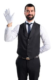 Luxury waiter saluting
