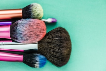 Makeup brush isolated on green background