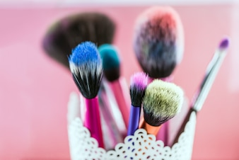 Makeup brush isolated on pink background
