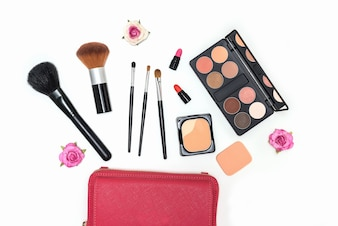 Makeup cosmetics palette and brushes on white background