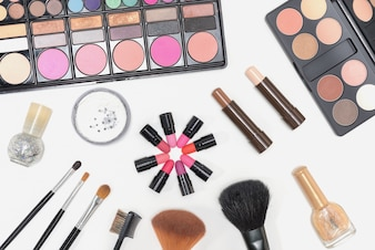 Makeup cosmetics palette lipstick and brushes