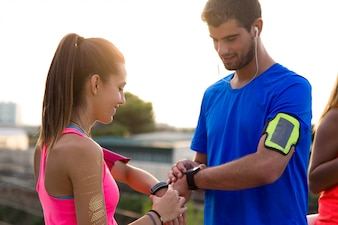 Man and woman comparing results of their exercise