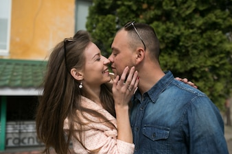 Man and woman hugging flirting touching noses