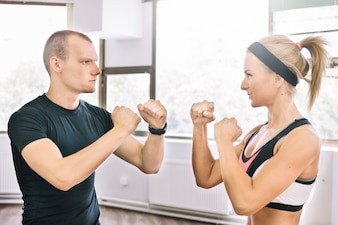 Man and woman in boxing position