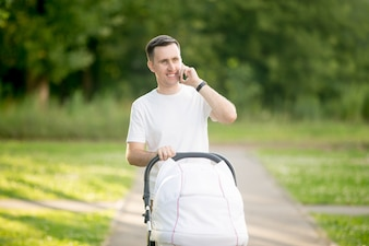 Man carrying a baby stroller